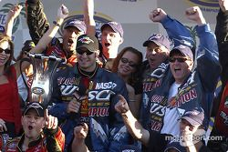 NASCAR Busch Series 2004 champion Martin Truex Jr. celebrates with team owners Teresa Earnhardt and Dale Earnhardt Jr.