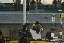 '2004 NASCAR NEXTEL Cup champion Kurt Busch raises the champion's flag