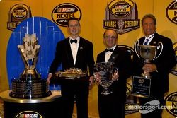 Kurt Busch, Jack Roush and Jimmy Fennig display the hardware they won in the NASCAR Nextel Cup Banquet