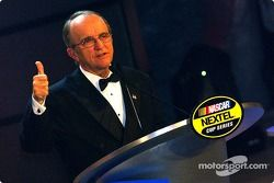 Championship owner Jack Roush gives a thumbs up during the banquet in New York