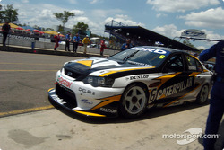 Craig Lowndes leaves the pits after a tyre change