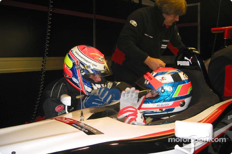 Matteo Bobbi and Fabrizio Gollin discuss the finer points of driving a Minardi F1x2 car after a run