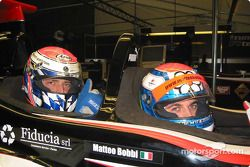 Former FIA GT World Champion, Matteo Bobbi, gives new FIA GT World Champion, Fabrizio Gollin, a ride