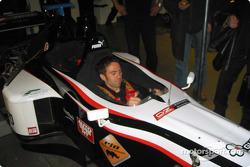 The 2001 and 2003 Giro d' Italia winner, Gilberto Simoni, in the Minardi F1X2 car