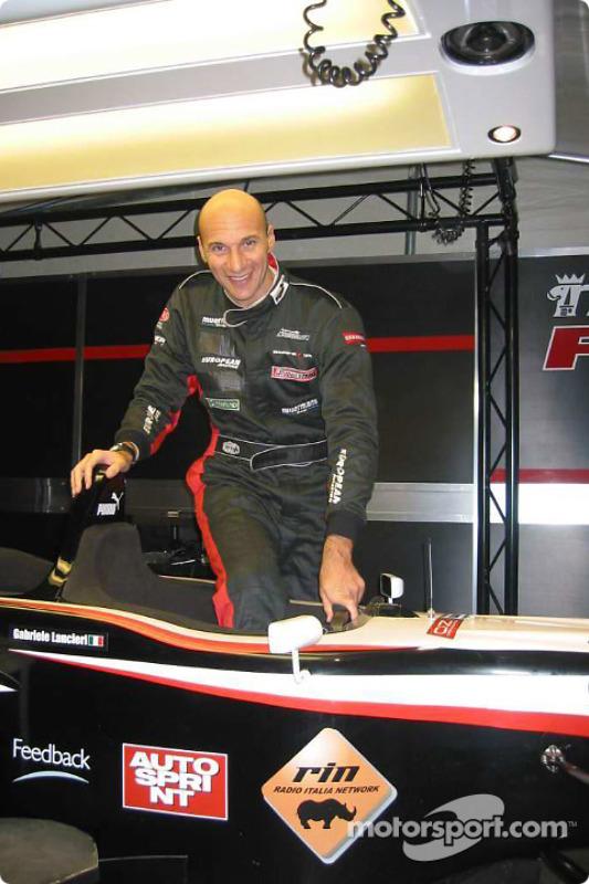 Free-diving record-breaker, Gianluca Genoni, climbs into the Minardi F1X2 car