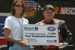 Bobby Hamilton Jr. receives a check