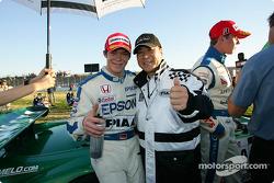 Race winner Andre Lotterer celebrates with team director Satoru Nakajima