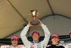 GT500 podium: race winner Andre Lotterer holds the trophy