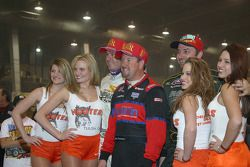 Cory Kruseman, P.J. Jones and Brian Gerster pose in Victory Lane with the Hooter's girls