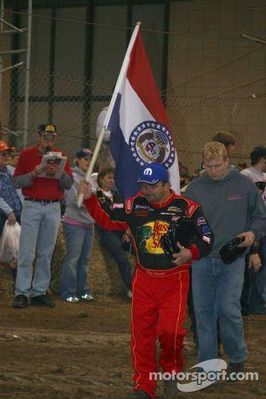 Danny Lasoski carries his state flag in pre race ceremonies