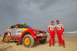 Car winners Stéphane Peterhansel and Jean-Paul Cottret celebrate on the beach
