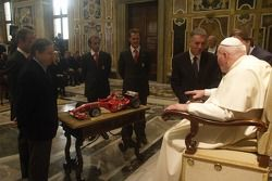 John Paul II The Pope receives a Ferrari F1 scaled model from Jean Todt, Rubens Barrichello, Luca Ba
