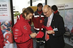 Jarno Trulli logos a Red Cross cap