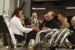 Visitors learn how Toyota manually builds its motor exhausts Fabrication