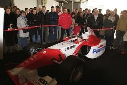 A young fan tries the Toyota F1 simulator