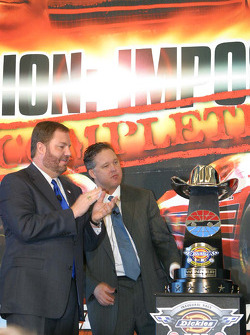 Eddie Gossage and Brian France admire the trophy for the new Nextel Cup Race at Texas Motor Speedway, the Dickies 500