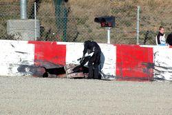 McLaren team members inspect the scene