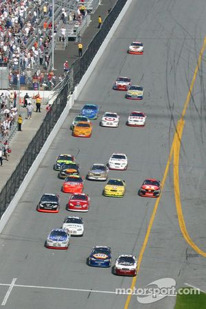 Michael Waltrip passes Dale Earnhardt Jr. approaching the checkered flag