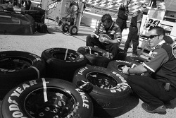 Scott's Ford crew members prepare wheels