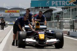 Red Bull team members push car
