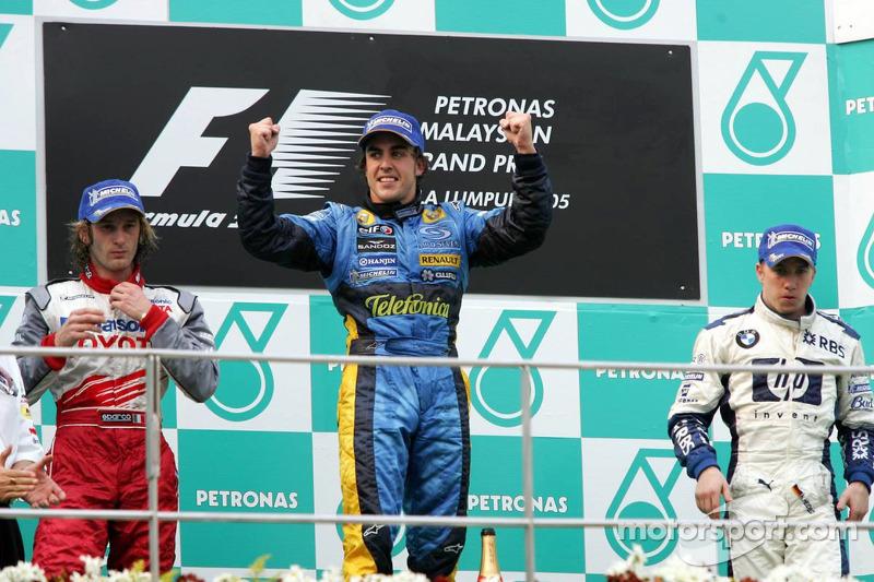 Podium: race winner Fernando Alonso with Jarno Trulli and Nick Heidfeld