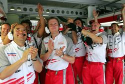 Toyota team members celebrate second place qualifying for Jarno Trulli