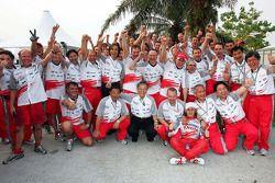 Jarno Trulli and Toyota team members celebrate