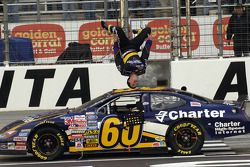 Race winner Carl Edwards does his traditional victory back flip