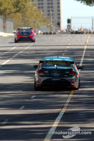 Marcos Ambrose stretching his lead over team mate Russell Ingall