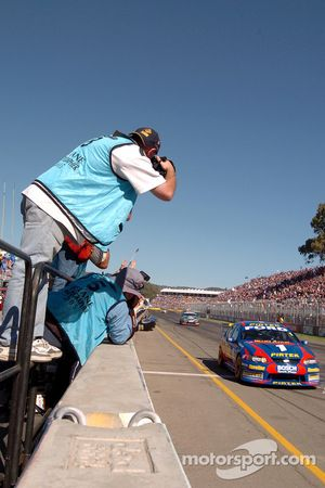 Marcos Ambrose, Russell Ingall and Craig Lowndes cross first, second and third