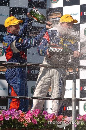 Marcos Ambrose showers Craig Lowndes