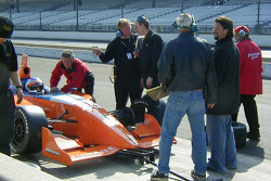 Grandpa Mario gives Marco Andretti some tips while father Michael looks on