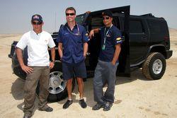Christian Klien,David Coulthard and Vitantonio Liuzzi try a Hummer in the Bahrain desert