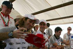 Autograph session for Jarno Trulli, Ralf Schumacher and Ricardo Zonta