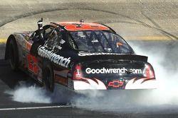 Race winner Kevin Harvick celebrates with a burnout