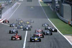 Start: Fernando Alonso leads Jarno Trulli and Michael Schumacher