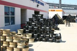 Stacks of rims sit ready to be mounted with race tires