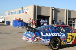 Kyle Busch's damaged car pulls into the garage