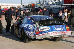 Kyle Busch's damaged car sits in the garage area