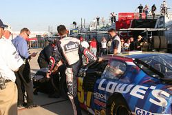 Kyle Busch climbs from his damaged car