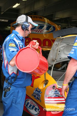 Rusty Wallace's crew member fills the car for a practice run
