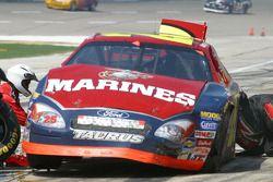 Work on Ashton Lewis Jr.'s damaged car on the pit lane