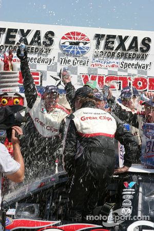 Kasey Kahne is showered by his crew