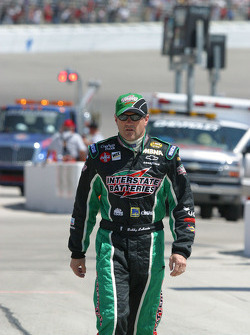 An ill Bobby Labonte walks down pit lane before the race