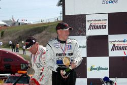 P1 podium: champagne for JJ Lehto and Andy Wallace