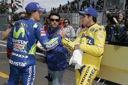 Marco Melandri congratulates pole winner Alex Barros