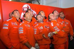 Ducati Corse team members watch qualifying