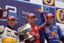 Podium: race winner Heikki Kovalainen with Jose Maria Lopez and Scott Speed