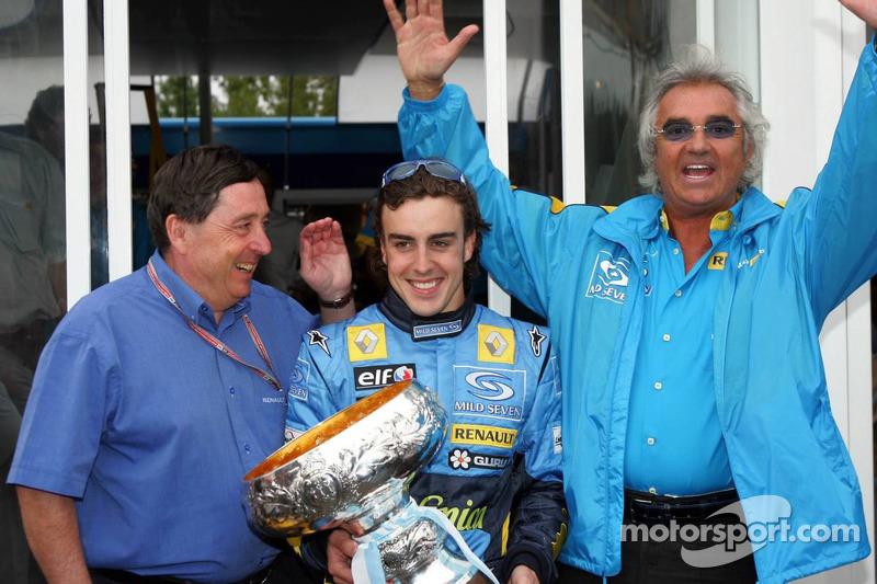 Race winner Fernando Alonso celebrates with Flavio Briatore and Patrick Faure