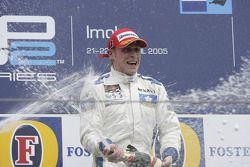 Podium: champagne for Adam Carroll